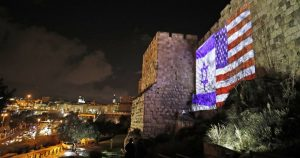 israeli and american flags side by side in Jeruselam